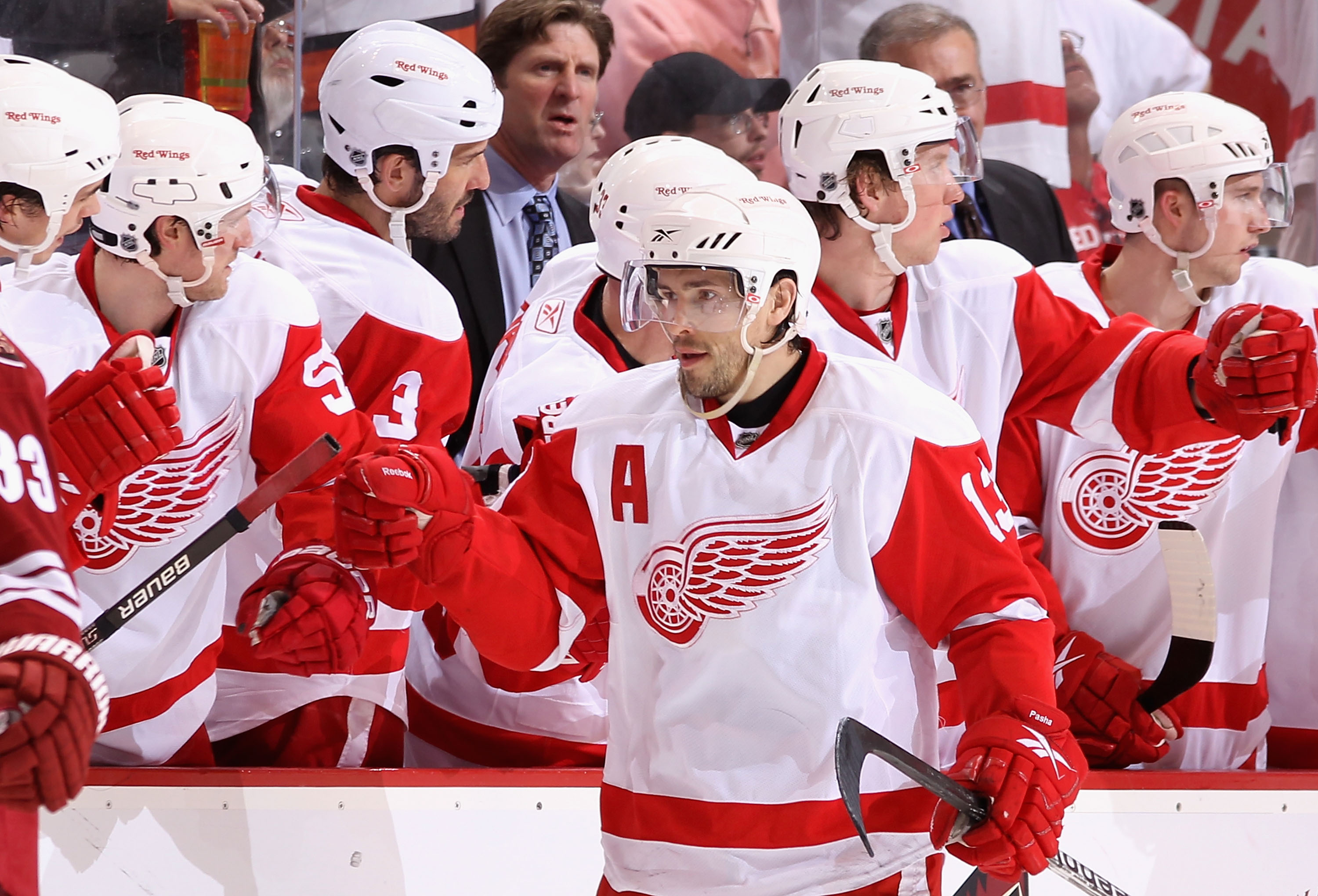 GLENDALE, AZ - APRIL 16:  Pavel Datsyuk #13 of the Detroit Red Wings celebrates with teammates on the bench after scoring a second period goal against the Phoenix Coyotes in Game Two of the Western Conference Quarterfinals during the 2010 NHL Stanley Cup