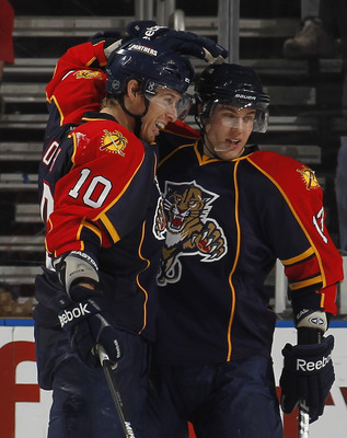 SUNRISE, FL - JANUARY 11: David Booth #10 is congratulated by Michael Santorelli #13 of the Florida Panthers after scoring a second period goal against the Washington Capitals on January 11, 2011 at the BankAtlantic Center in Sunrise, Florida. (Photo by J