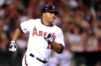 ANAHEIM, CA - APRIL 22:  Vernon Wells #10 of the Los Angeles Angels runs to first base against the Boston Red Sox at Angel Stadium on April 22, 2011 in Anaheim, California.  (Photo by Harry How/Getty Images)
