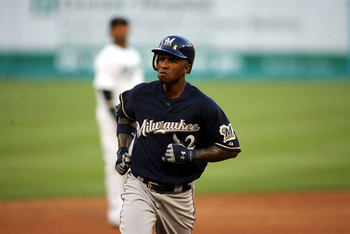 MIAMI GARDENS, FL - JUNE 04:  Nyjer Morgan #2 of the Milwaukee Brewers hits a home run against the Florida Marlins at Sun Life Stadium on June 4, 2011 in Miami Gardens, Florida.  (Photo by Marc Serota/Getty Images)