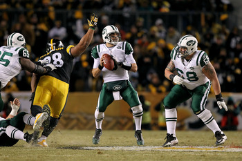PITTSBURGH, PA - JANUARY 23:  Mark Sanchez #6 of the New York Jets scrambles against Casey Hampton #98 of the Pittsburgh Steelers during the 2011 AFC Championship game at Heinz Field on January 23, 2011 in Pittsburgh, Pennsylvania.  (Photo by Al Bello/Get