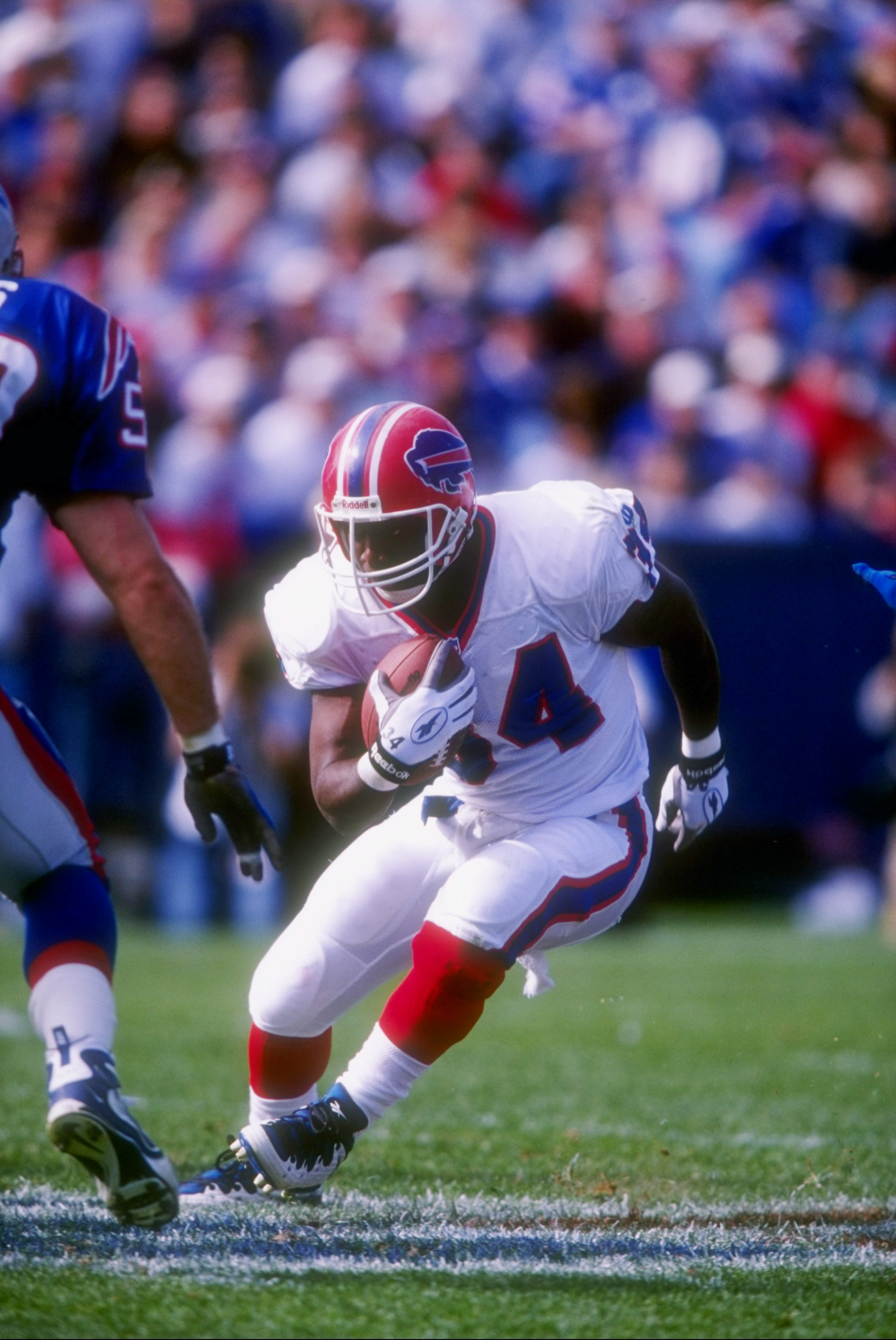12 Oct 1997: Running back Thurman Thomas of the Buffalo Bills runs with the ball during a game against the New England Patriots at Foxboro Stadium in Foxboro, Massachusetts. The Patriots won the game 33-6.