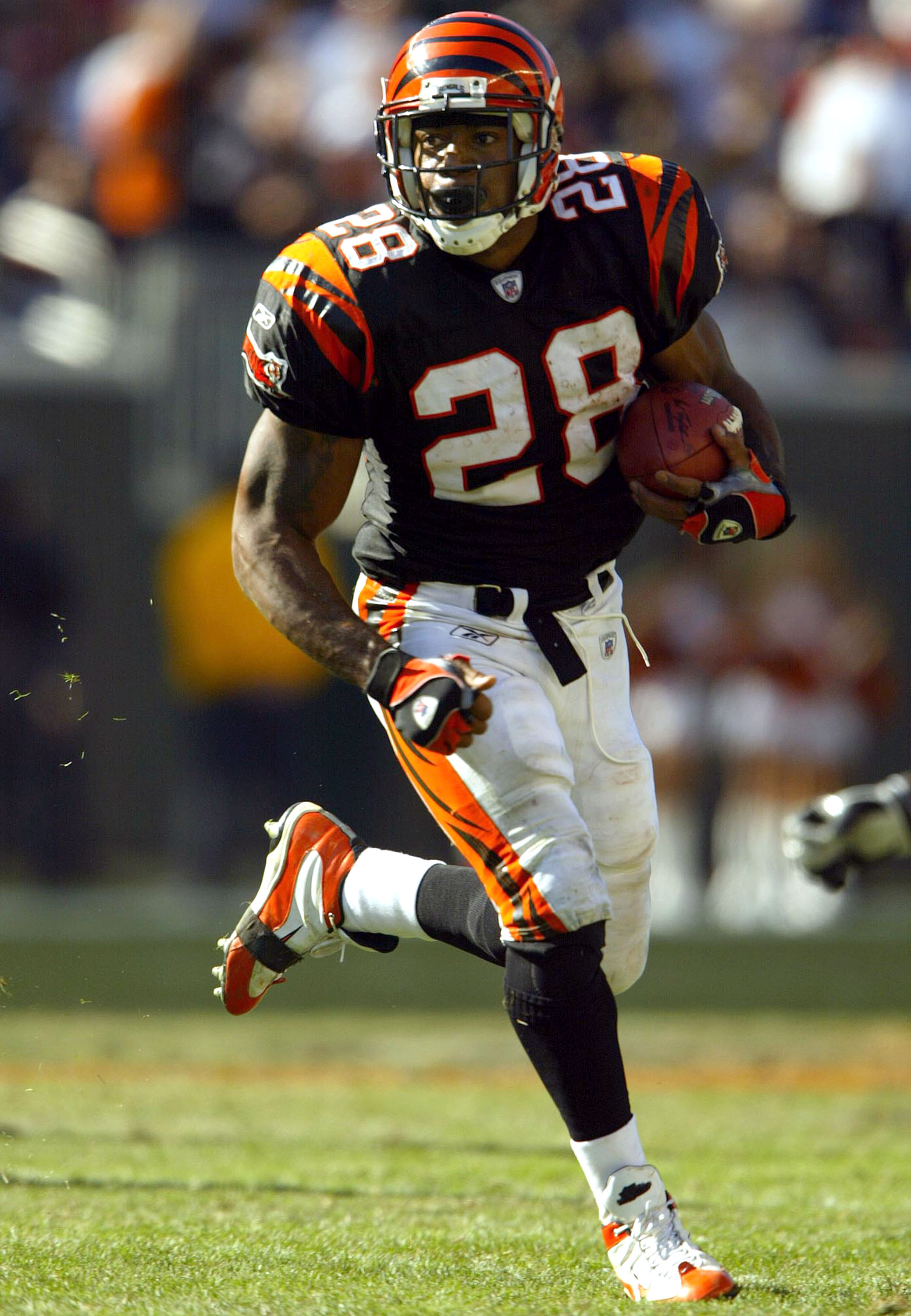CINCINNATI, OH - OCTOBER 19:  Corey Dillon #28 of the Cincinnati Bengals runs with the ball against the Baltimore Ravens during the 34-26 Bengals win over the Ravens October 19, 2003 at Paul Brown Stadium in Cincinnati, Ohio.  (Photo by Andy Lyons/Getty I