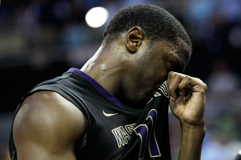 CHARLOTTE, NC - MARCH 20:  Matthew Bryan-Amaning #11 of the Washington Huskies reacts after the Huskies were defeated 86-83 by the North Carolina Tar Heels during the third round of the 2011 NCAA men's basketball tournament at Time Warner Cable Arena on M