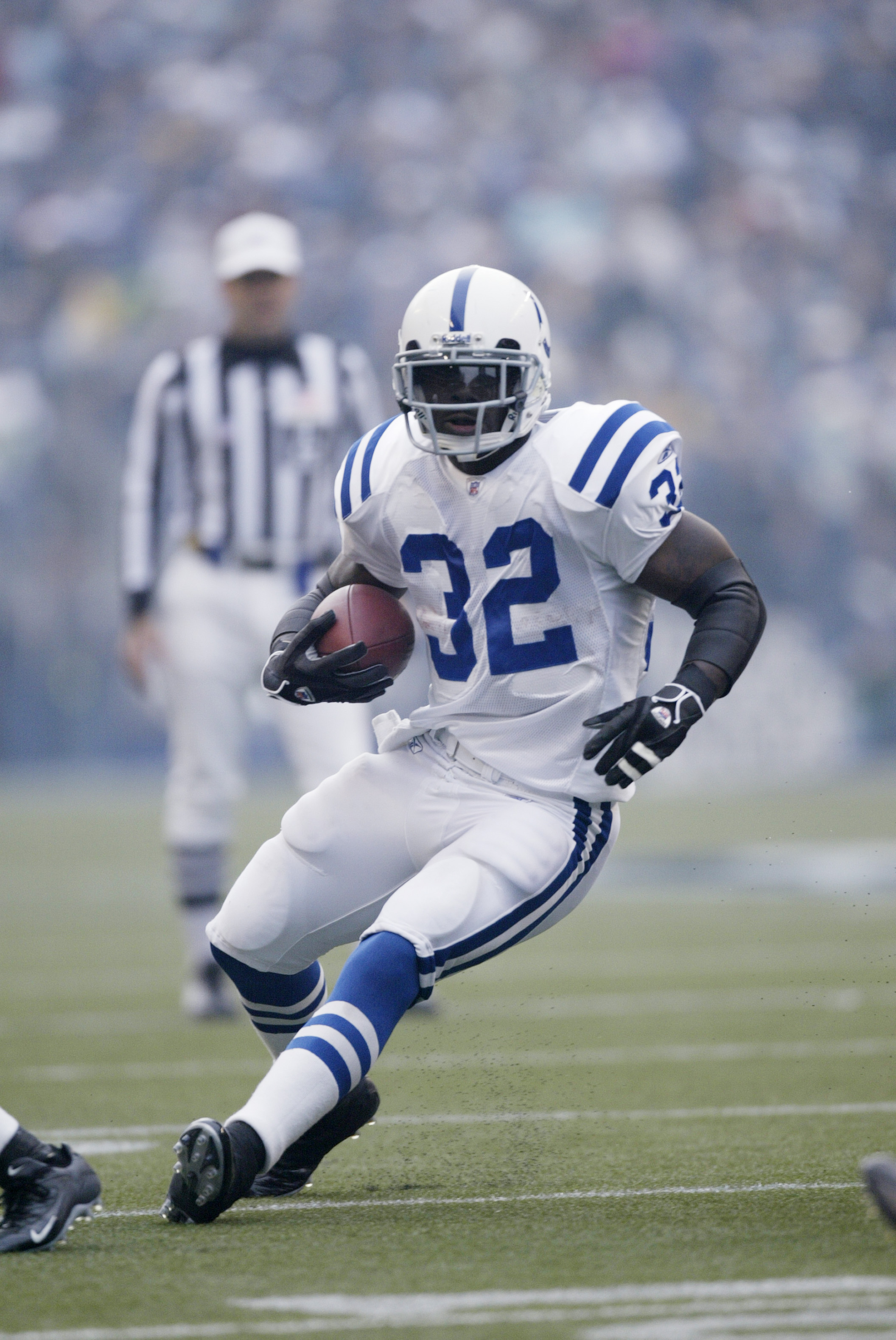 SEATTLE - DECEMBER 24:  Running back Edgerrin James #32 of the Indianapolis Colts carries the ball against the Seattle Seahawks at Qwest Field on December 24, 2005 in Seattle, Washington. The Seahawks defeated the Colts 28-13.  (Photo by Otto Greule Jr/Ge