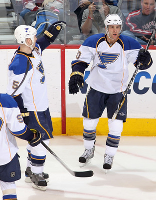 GLENDALE, AZ - MARCH 02:  Andy McDonald #10 of the St. Louis Blues celebrates with teammates David Perron #57, Barret Jackman #5 and Patrik Berglund #21 after McDonald scored a second period goal against the Phoenix Coyotes during the NHL game at Jobing.c