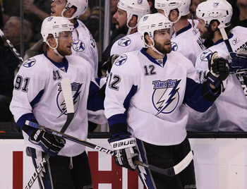 BOSTON, MA - MAY 23:  Simon Gagne #12 and Steven Stamkos #91 of the Tampa Bay Lightning celebrate Gagne's first period goal with teammates in Game Five of the Eastern Conference Finals against the Boston Bruins during the 2011 NHL Stanley Cup Playoffs at