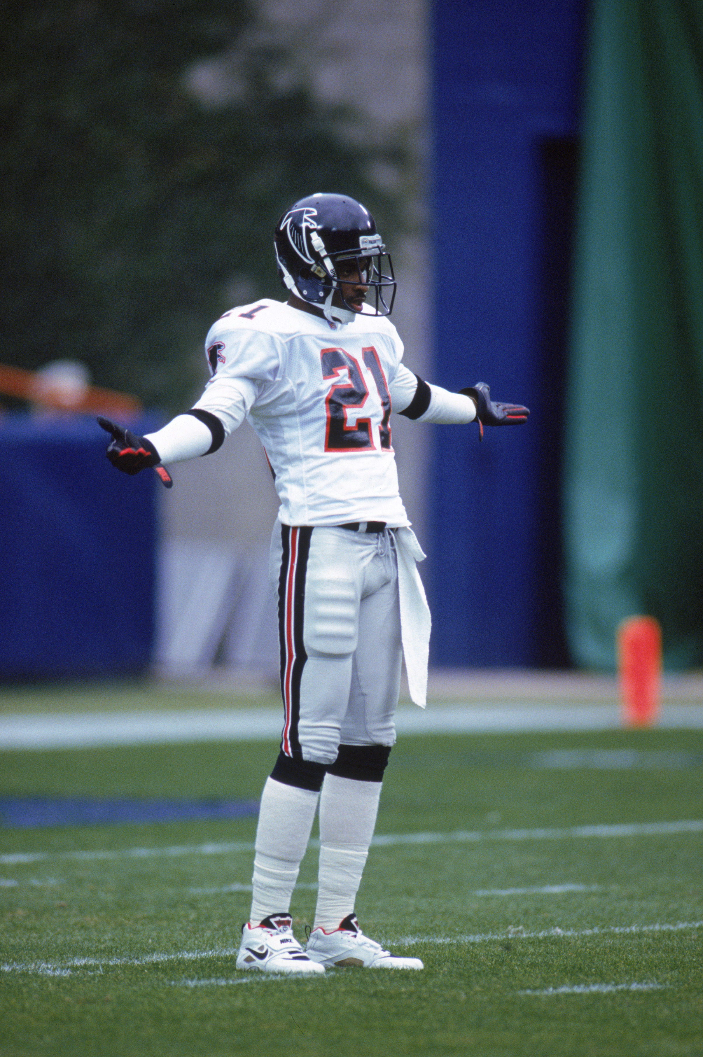 ANAHEIM, CA - DECEMBER 27:  Defensive back Deion Sanders #21 of the Atlanta Falcons strikes a pose as he waits for play during a game against the Los Angeles Rams at Anaheim Stadium on December 27, 1992 in Anaheim, California.  The Rams won 38-27.  (Photo