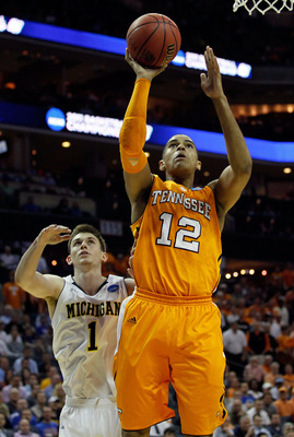 CHARLOTTE, NC - MARCH 18:  Tobias Harris #12 of the Tennessee Volunteers lays the ball up in front of Stu Douglass #1 of the Michigan Wolverines in the first half during the second round of the 2011 NCAA men's basketball tournament at Time Warner Cable Ar