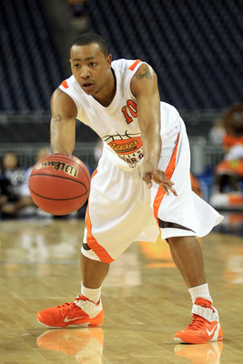 HOUSTON, TX - APRIL 01:  Andrew Goudelock #10 of the College of Charleston passes the ball in the 2011 Reese's College All-Star Game after practice for the 2011 Final Four of the NCAA Division I Men's Basketball Tournament at Reliant Stadium on April 1, 2