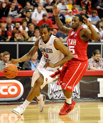 LAS VEGAS, NV - MARCH 10:  Kawhi Leonard #15 of the San Diego State Aztecs drives against Josh Watkins #15 of the Utah Utes during a quarterfinal game of the Conoco Mountain West Conference Basketball tournament at the Thomas & Mack Center March 10, 2011