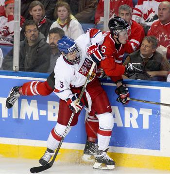 BUFFALO, NY - DECEMBER 28: Martin Frk #5 of the Czech Republic checks Erick Gudbranson #5 of Canada during the 2011 IIHF World U20 Championship game between Canada and the Czech Republic at the HSBC Arena on December 28, 2010 in Buffalo, New York. Canada