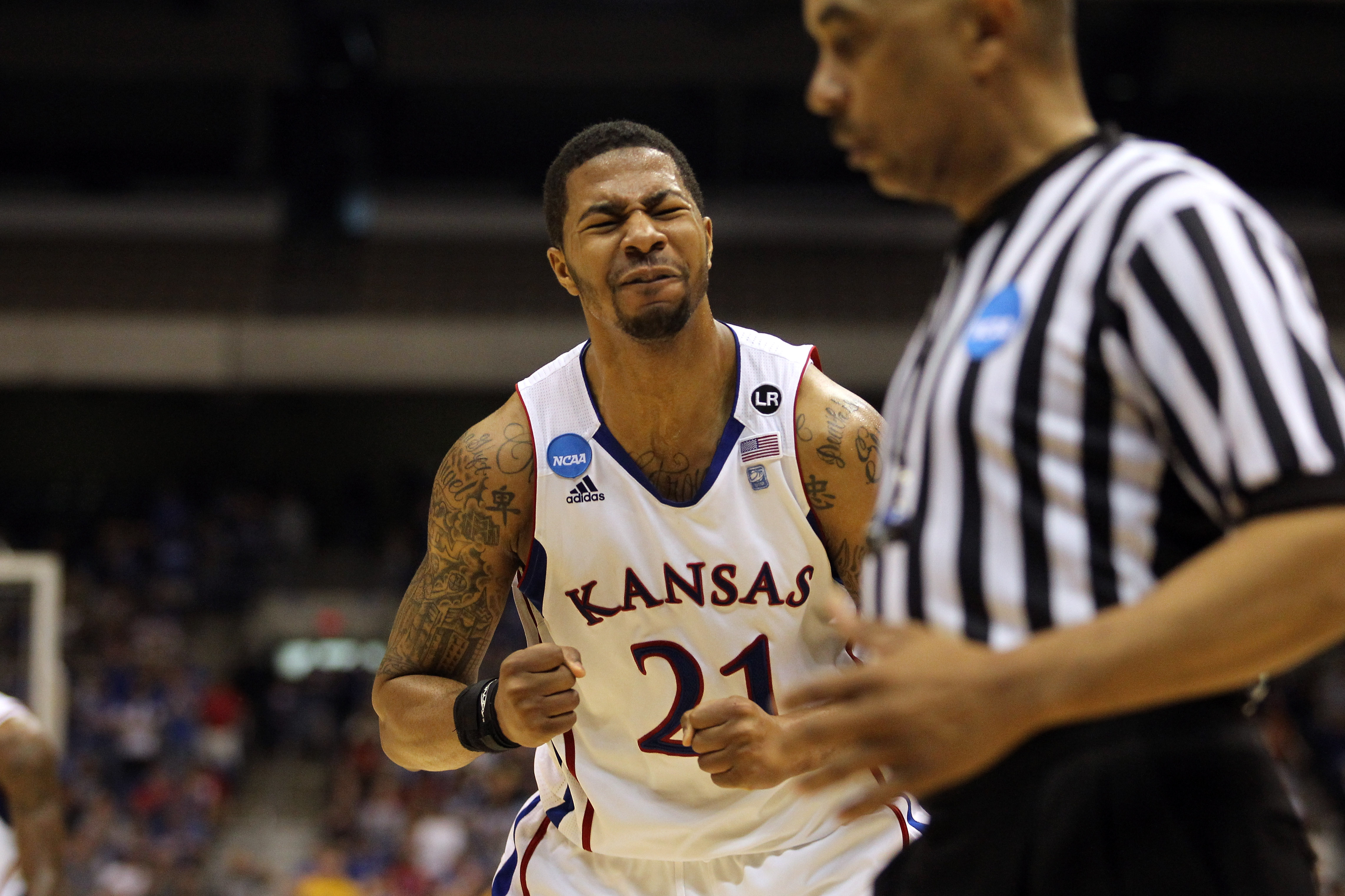SAN ANTONIO, TX - MARCH 27:  Markieff Morris #21 of the Kansas Jayhawks reacts during the southwest regional final of the 2011 NCAA men's basketball tournament against the Virginia Commonwealth Rams at the Alamodome on March 27, 2011 in San Antonio, Texas