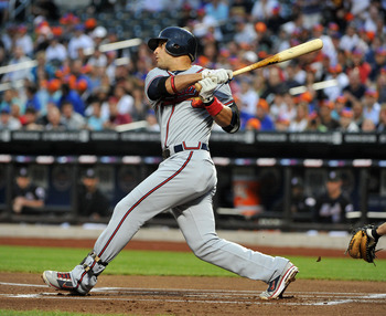 NEW YORK, NY - JUNE 04: Martin Prado #14 of the Atlanta Braves watches his first inning single against the New York Mets at Citi Field on June 4, 2011 in the Flushing neighborhood of the Queens borough of New York City. (Photo by Christopher Pasatieri/Get