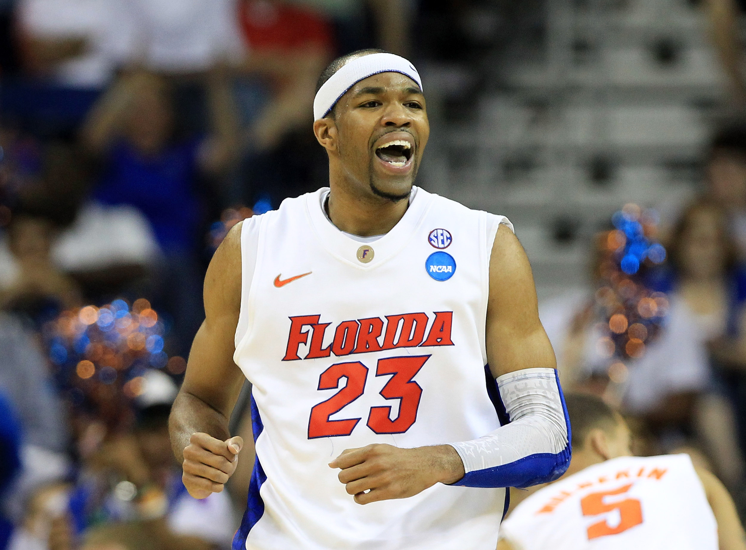 NEW ORLEANS, LA - MARCH 26:  Alex Tyus #23 of the Florida Gators celebrates during the second half of their game against the Butler Bulldogs in the Southeast regional final of the 2011 NCAA men's basketball tournament at New Orleans Arena on March 26, 201