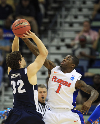 NEW ORLEANS, LA - MARCH 24:  Jimmer Fredette #32 of the Brigham Young Cougars shoots against Kenny Boynton #1 of the Florida Gators in the first half during the Southeast regional of the 2011 NCAA men's basketball tournament at New Orleans Arena on March