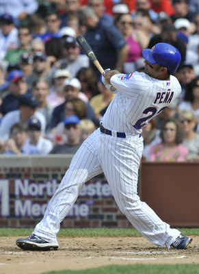 CHICAGO, IL - JUNE 18:  Carlos Pena # 22 of the Chicago Cubs hits a 2-run home run against the New York Yankees in the fourth inning on June 18, 2011 at Wrigley Field in Chicago, Illinois.  (Photo by David Banks/Getty Images)