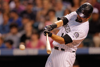 DENVER, CO - JUNE 14:  Todd Helton #17 of the Colorado Rockies singles to center field off of Wade LeBlanc of the San Diego Padres in the sixth inning at Coors Field on June 14, 2011 in Denver, Colorado. (Photo by Justin Edmonds/Getty Images)