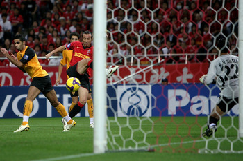 SAITAMA, JAPAN - SEPTEMBER 24:  Marcus Tulio Tanaka of Urawa Red Diamonds scores a goal against Al Qadsia during the Asia Champions League quarter final 2nd leg match between Urawa Red Diamonds and Al Qadsia at Saitama Stadium on September 24, 2008 in Sai