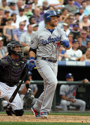 DENVER, CO - JUNE 12: James Loney #7 of the Los Angeles Dodgers takes off for first base after hitting the ball against the Colorado Rockies on June 12, 2011 at Coors Field in Denver, Colorado. The Dodgers won the game 10-8. (Photo by Marc Piscotty/Getty