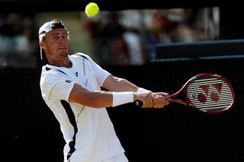 LONDON, ENGLAND - JUNE 28:  Lleyton Hewitt of Australia in action during his match against Novak Djokovic of Serbia on Day Seven of the Wimbledon Lawn Tennis Championships at the All England Lawn Tennis and Croquet Club on June 28, 2010 in London, England