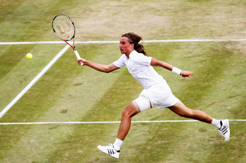 LONDON, ENGLAND - JUNE 24:  Alexandr Dolgopolov of Ukraine in action during his second round match against Jo-Wilfried Tsonga of France on Day Four of the Wimbledon Lawn Tennis Championships at the All England Lawn Tennis and Croquet Club on June 24, 2010