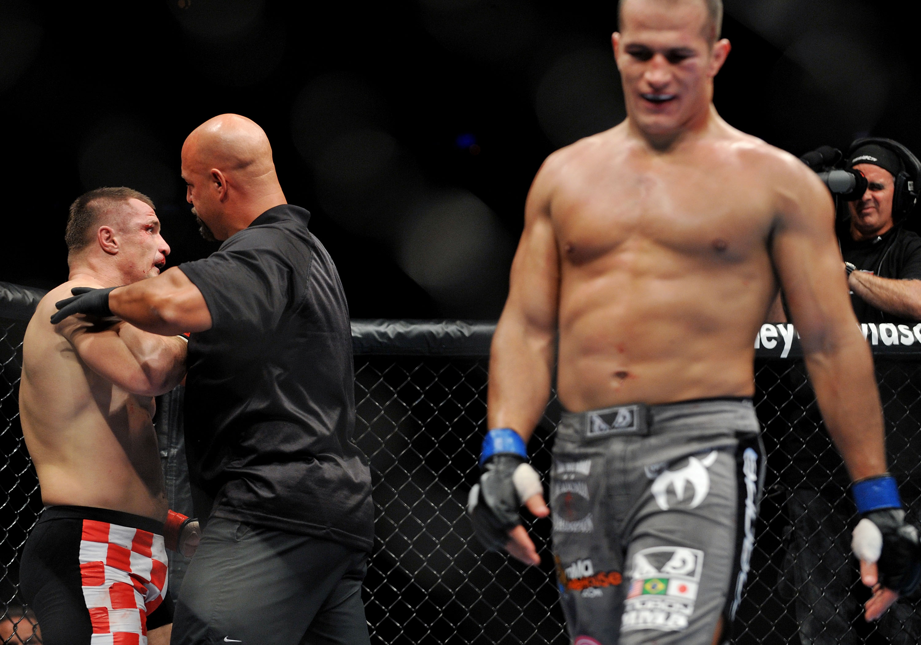 DALLAS - SEPTEMBER 19:  UFC fighter Mirko Cro Cop (L) is stopped by referee after losing to opponent UFC fighter Junior Dos Santo (R) during their Heavyweight bout at UFC 103: Franklin vs. Belfort at the American Airlines Center on September 19, 2009 in D