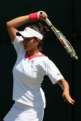 WIMBLEDON, ENGLAND - JUNE 24:  Sania Mirza of India plays a forehand during the women's singles second round match against Sorana Cirstea of Romania on Day Three of the Wimbledon Lawn Tennis Championships at the All England Lawn Tennis and Croquet Club on