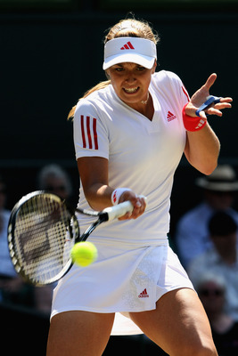 WIMBLEDON, ENGLAND - JUNE 30:  Sabine Lisicki of Germany plays a forehand during the women's singles quarter final match against Dinara Safina of Russia on Day Eight of the Wimbledon Lawn Tennis Championships at the All England Lawn Tennis and Croquet Clu