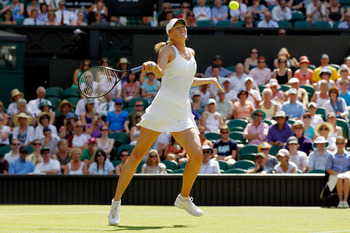 LONDON, ENGLAND - JUNE 28:  Maria Sharapova of Russia in action during her match against Serena Williams of USA on Day Seven of the Wimbledon Lawn Tennis Championships at the All England Lawn Tennis and Croquet Club on June 28, 2010 in London, England.  (