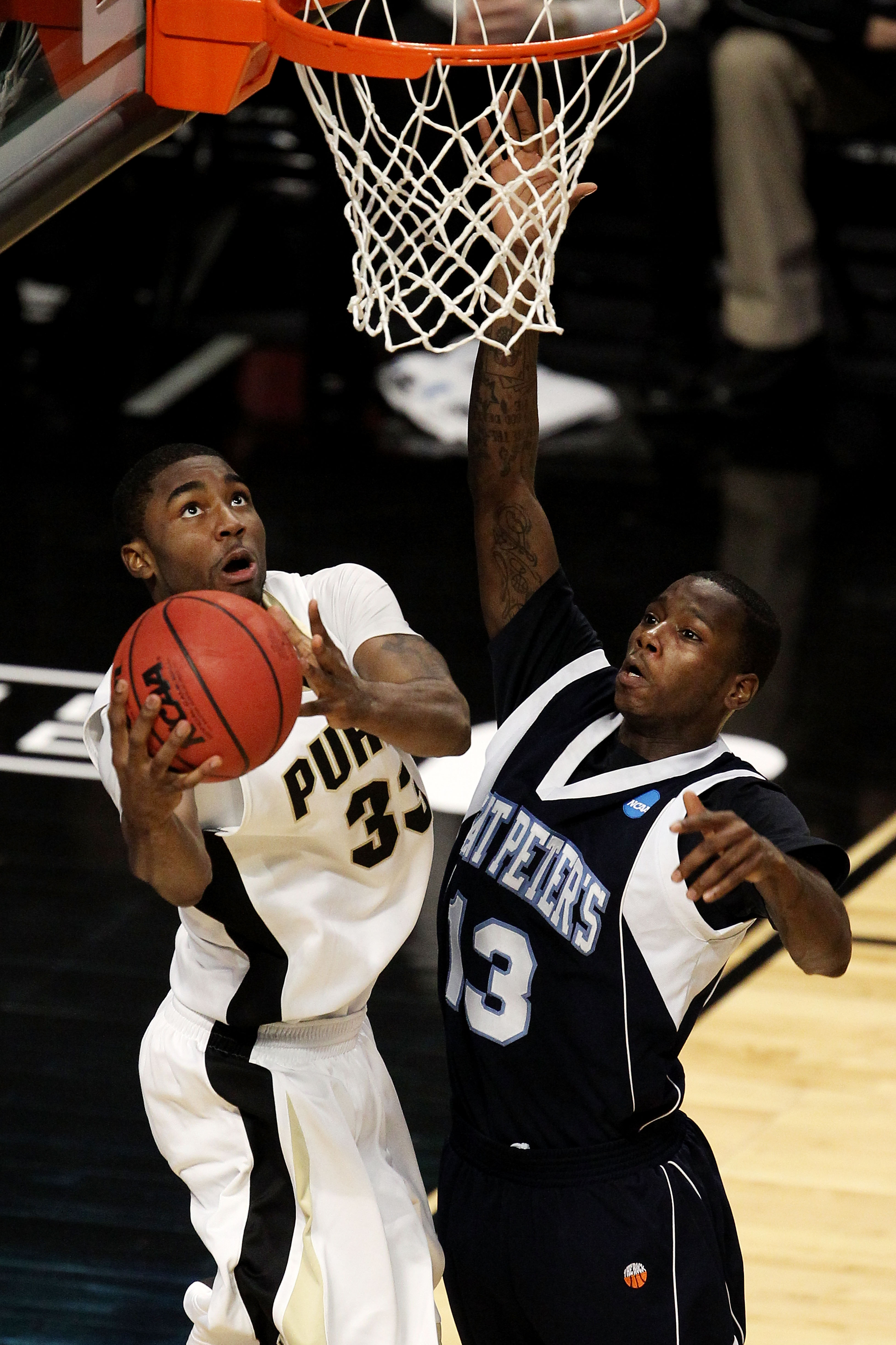 CHICAGO, IL - MARCH 18:  E'Twaun Moore #33 of the Purdue Boilermakers shoots against Steven Samuels #13 of the St. Peter's Peacocks in the second half during the second round of the 2011 NCAA men's basketball tournament at the United Center on March 18, 2
