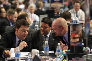 MONTREAL - JUNE 26:  Colorado Avalanche General Manager Greg Sherman (l) confers with scouts Richard Pracey and Alan Hepple during the first round of the 2009 NHL Entry Draft at the Bell Centre on June 26, 2009 in Montreal, Quebec, Canada. (Photo by Bruce