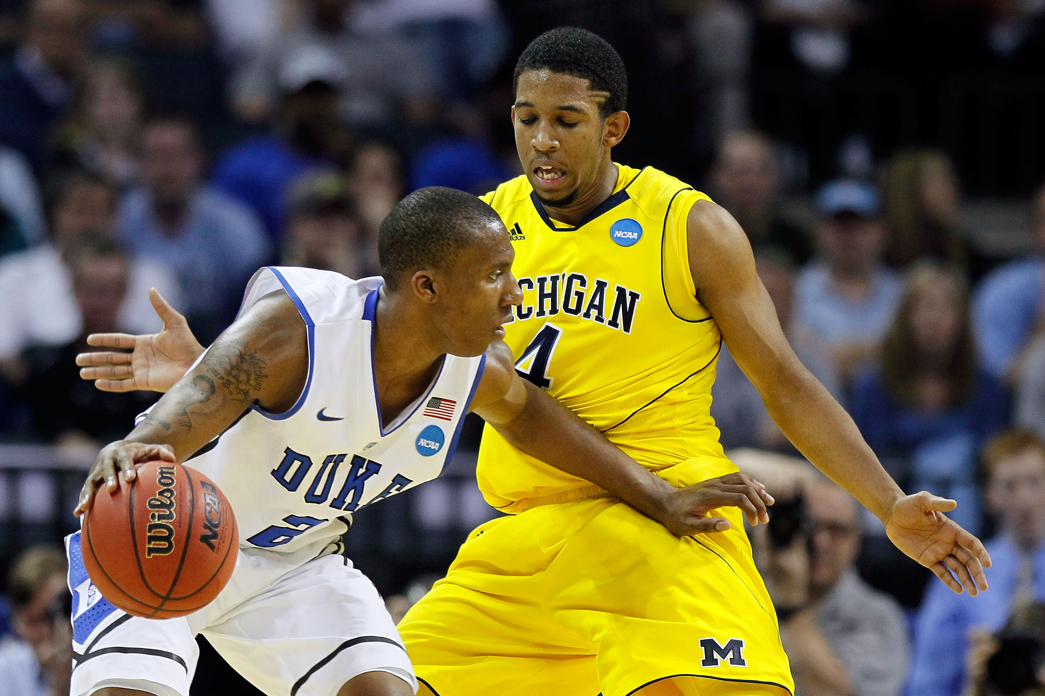 CHARLOTTE, NC - MARCH 20:  Nolan Smith #2 of the Duke Blue Devils moves the ball against Darius Morris #4 of the Michigan Wolverines during the third round of the 2011 NCAA men's basketball tournament at Time Warner Cable Arena on March 20, 2011 in Charlo