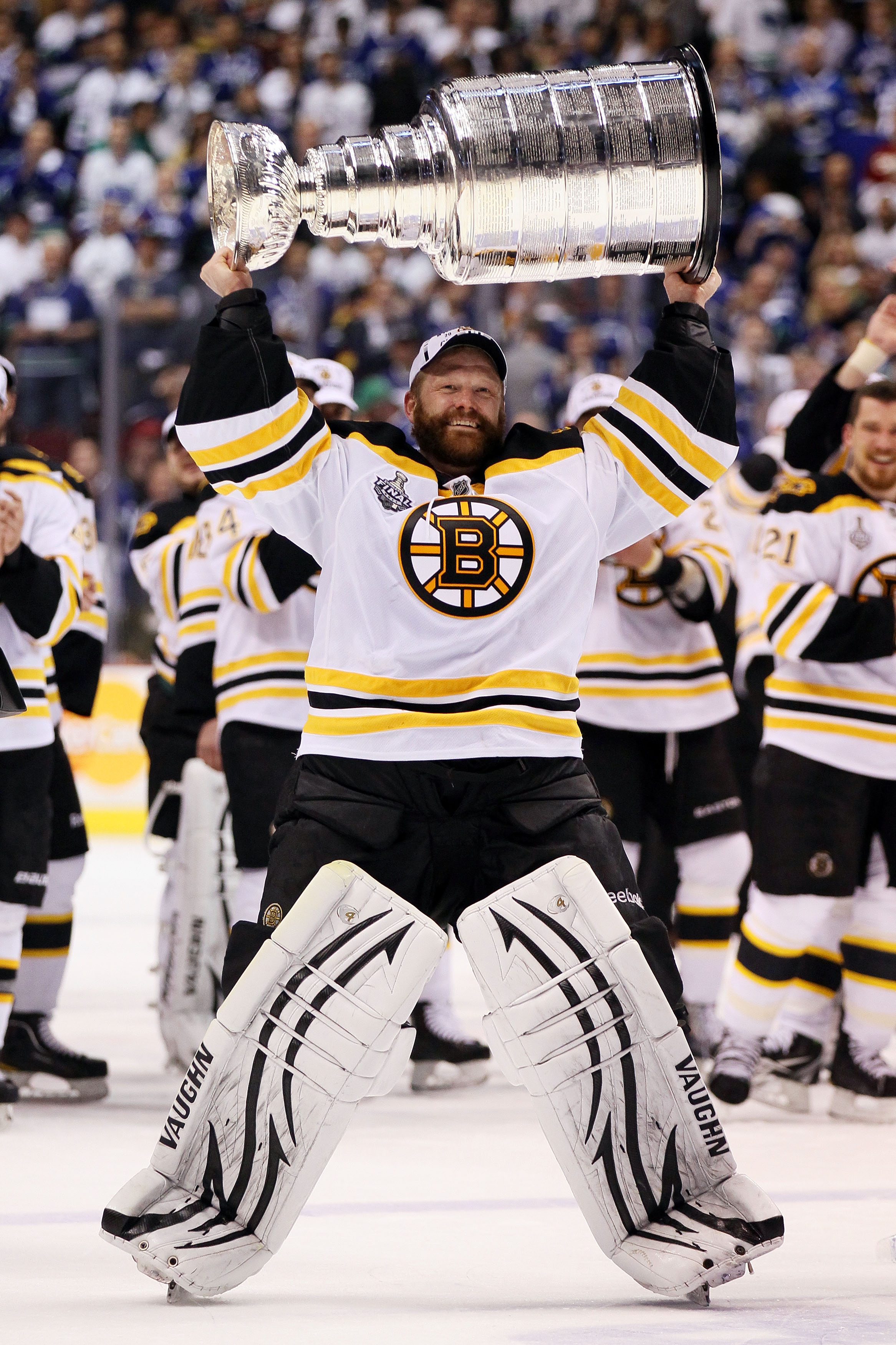 Tim Thomas hoist's the Stanley Cup after a 4-0 victory in game seven over the Vancouver Canucks