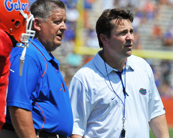 GAINESVILLE, FL - APRIL 9:  Coach Will Muschamp and offensive coordinator Charlie Weis of the Florida Gators direct play during the Orange and Blue spring football game April 9, 2010 Ben Hill Griffin Stadium in Gainesville, Florida.  (Photo by Al Messersc