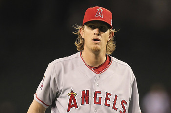 SEATTLE - JUNE 14:  Starting pitcher Jered Weaver #36 of the Los Angeles Angels of Anaheim reacts as the final out is made in a complete game 4-0 shutout against the Seattle Mariners at Safeco Field on June 14, 2011 in Seattle, Washington. (Photo by Otto