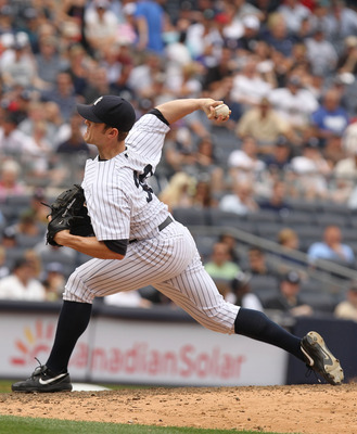 NEW YORK, NY - JUNE 16:  David Robertson #30 of the New York Yankees in action against the Texas Rangers during their game on June 16, 2011 at Yankee Stadium in the Bronx borough of New York City.  (Photo by Al Bello/Getty Images)