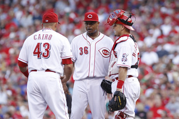 CINCINNATI, OH - JUNE 7: Edinson Volquez #36 of the Cincinnati Reds meets at the mound with catcher Ramon Hernandez #55 and third baseman Miguel Cairo #43 during the game against the Chicago Cubs at Great American Ball Park on June 7, 2011 in Cincinnati,