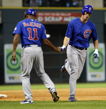 HOUSTON - APRIL 12:  Tyler Colvin #21 of the Chicago Cubs receives congratulations from third base coach  Ivan De Jesus after hitting a home run in the seventh inning against the Houston Astros at Minute Maid Park on April 12, 2011 in Houston, Texas.  (Ph