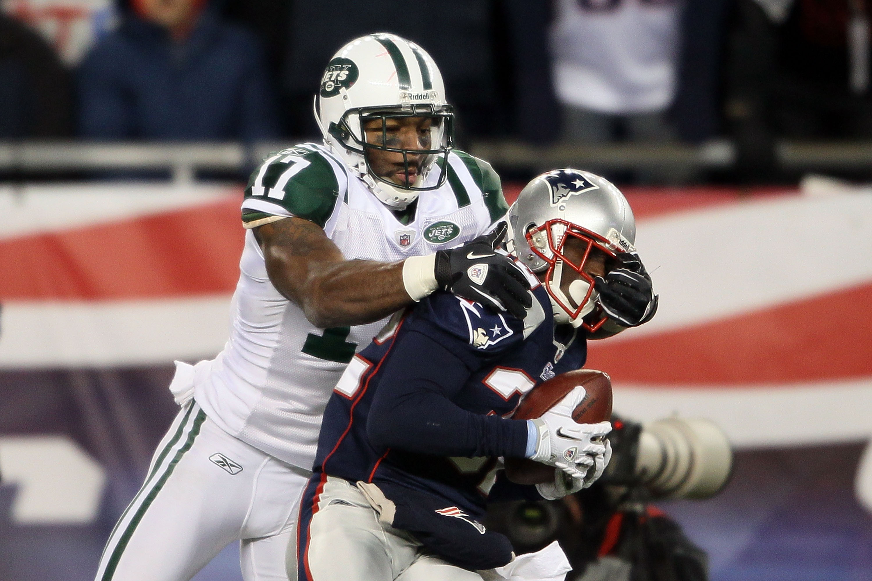 FOXBORO, MA - DECEMBER 06:  Devin McCourty #32 of the New England Patriots intercepts a pass against Braylon Edwards #17 of the New York Jets at Gillette Stadium on December 6, 2010 in Foxboro, Massachusetts. The Patriots won 45-3. (Photo by Elsa/Getty Im