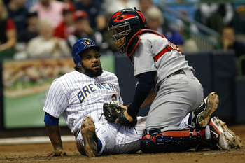MILWAUKEE, WI - JUNE 10: Yadier Molina #4 of the St. Louis Cardinals tags out Prince Fielder #28 of the Milwaukee Brewers at home plate at Miller Park on June 10, 2011 in Milwaukee, Wisconsin. (Photo by Scott Boehm/Getty Images)