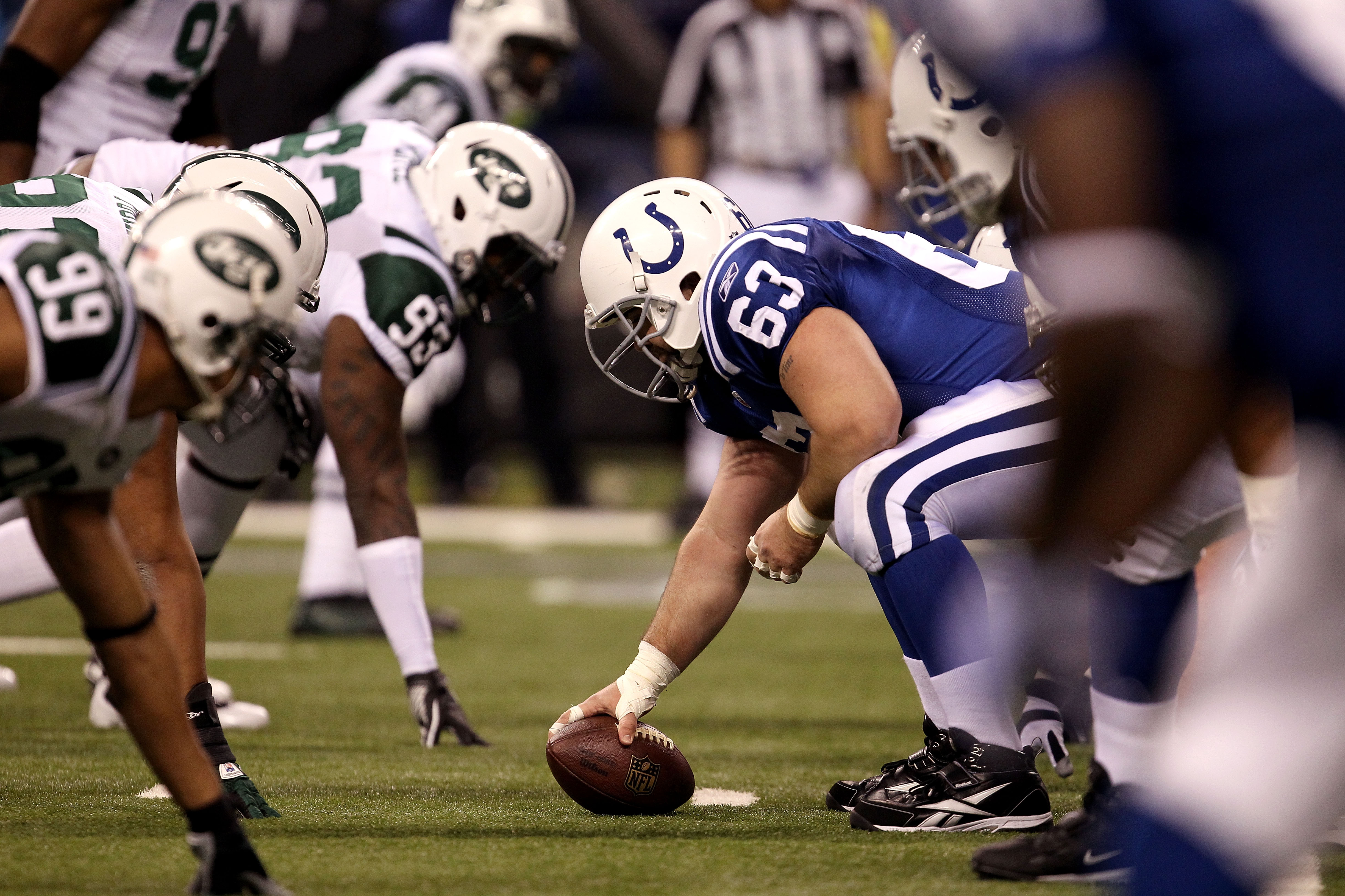 INDIANAPOLIS, IN - JANUARY 08:  Center Jeff Saturday #63 of the Indianapolis Colts readies to snap the ball against the New York Jets during their 2011 AFC wild card playoff game at Lucas Oil Stadium on January 8, 2011 in Indianapolis, Indiana. The Jets w