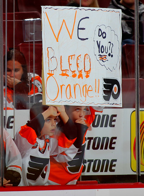 PHILADELPHIA - OCTOBER 23: Philadelphia Flyers fans holding a sign during warmups before a hockey game against the Toronto Maple Leafs at the Wells Fargo Center on October 23, 2010 in Philadelphia, Pennsylvania.  (Photo by Paul Bereswill/Getty Images)