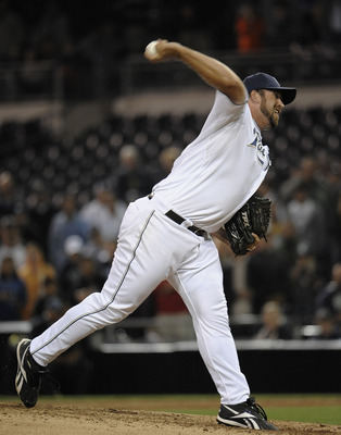 SAN DIEGO, CA - JUNE 7: Heath Bell #21 of the San Diego Padres pitches during the ninth inning of a baseball game against the Colorado Rockies at Petco Park on June 7, 2011 in San Diego, California.  (Photo by Denis Poroy/Getty Images)
