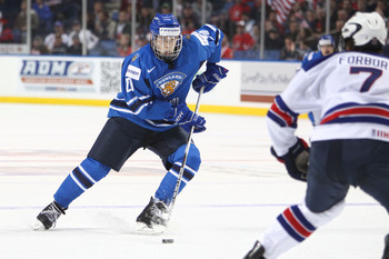 BUFFALO, NY - DECEMBER 26:  Joel Armia #20 of Finland carries the puck during the 2011 IIHF World U20 Championship Group A game between USA and Finland on December 26, 2010 at HSBC Arena in Buffalo, New York. (Photo by Tom Szczerbowski/Getty Images)