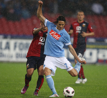 NAPLES, ITALY - APRIL 30:  Edinson Cavani (R) of SSC Napoli in action during the Serie A match between SSC Napoli and Genoa CFC at Stadio San Paolo on April 30, 2011 in Naples, Italy.  (Photo by Paolo Bruno/Getty Images)