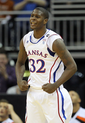 KANSAS CITY, MO - MARCH 10:  Josh Selby #32 of the Kansas Jayhawks reacts to a play against the Oklahoma State Cowboys during their quarterfinal game in the 2011 Phillips 66 Big 12 Men's Basketball Tournament at Sprint Center on March 10, 2011 in Kansas C