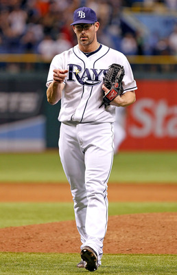 ST. PETERSBURG, FL - JUNE 17:  Pitcher Kyle Farnsworth #43 of the Tampa Bay Rays celebrates his save against the Florida Marlins at Tropicana Field on June 17, 2011 in St. Petersburg, Florida.  (Photo by J. Meric/Getty Images)