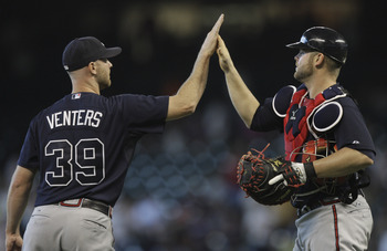 HOUSTON - JUNE 12:  Pitcher Jonny Venters #39 of the Atlanta Braves high fives catcher Brian McCann #16 after the final out against the Houston Astros at Minute Maid Park on June 12, 2011 in Houston, Texas.  (Photo by Bob Levey/Getty Images)