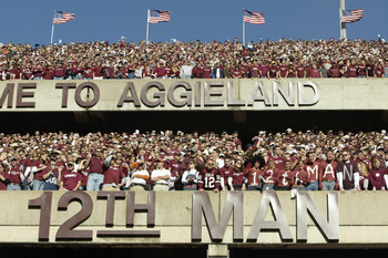 COLLEGE STATION, TX - NOVEMBER 28:  Texas A&M University Aggies fans, sometimes referred to as the 12th Man, stand during the game against the University of Texas at Austin Longhorns, at Kyle Field on November 28, 2003 in College Station, Texas.  The Texa